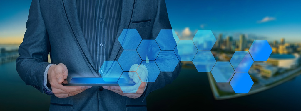 A man holding a tablet with animated shapes coming from the tablet
